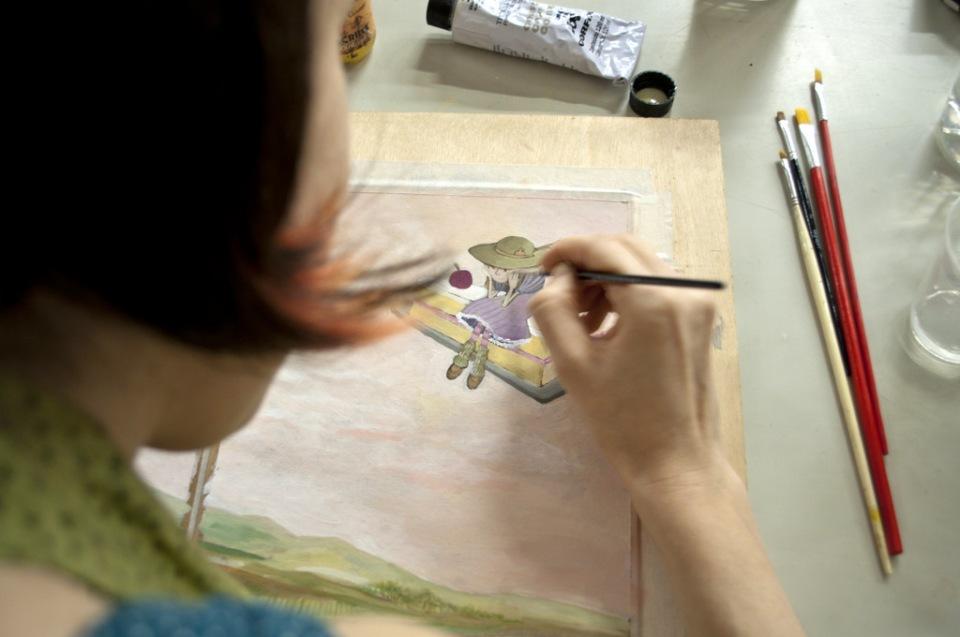 Martha Werneck ilustrando O DONO DA LUA - foto de Marcia Casturino